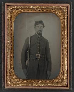 Unidentified private in Confederate uniform and Georgia frame buckle with bayoneted musket. From the Library of Congress Liljenquist Family Collection of Civil War Photographs, AMB/TIN no. 2833 [P&P].