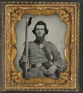 Unidentified soldier in Confederate uniform and Georgia state seal belt buckle with musket. From the Library of Congress Liljenquist Family of Civil War Photographs, AMB/TIN no. 2991 [P&P].